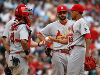 Cardinals fined, must give up draft picks