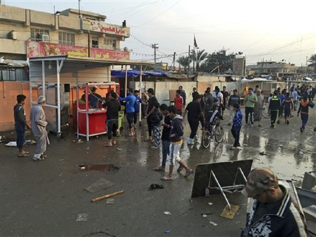 Death toll from is bombing of baghdad market now at 73 kgun9 com