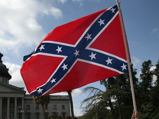 Protesters fly Confederate flag at NCAA games