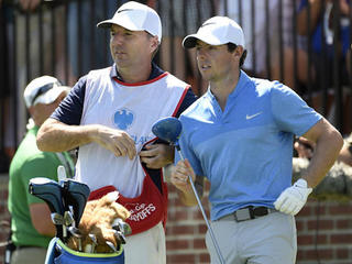Rory McIlroy makes his caddie very happy