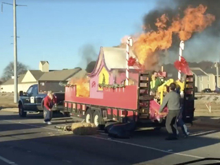 'Grinch' flicks cigarette, catches float on fire