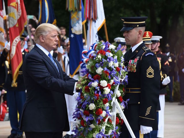 Trump places wreath at Arlington
