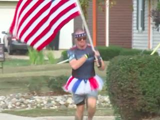Michigan 'Tutu Man' runs with American flag